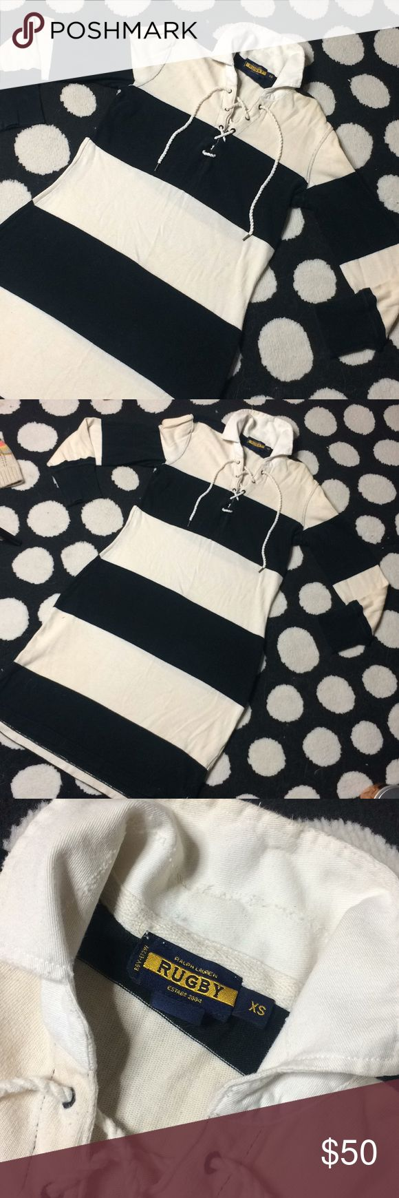 Rugby Ralph Lauren Classic Rugby Style Mini Dress Look stylish and stay comfy with this adorable, edgy & fun Rugby by Ralph Lauren Classic Black & White striped Rugby Mini Dress.  Edgy, distressed details, embroidered Skull Rugby logo under collar displays when collar is popped, Lace up detail.  Can double as a tunic as well!  The perfect year round piece! Pair with your favorite riding boots & blazer for a day friendly, classic office look or pair with your favorite accessories for a…