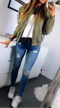 I love these fall winter outfit ideas that anyone can wear teen girls or women. The ultimate fall fashion guide for high school or college. Cute simple look with ripped blue jeans sneakers and a green bomber jacket.