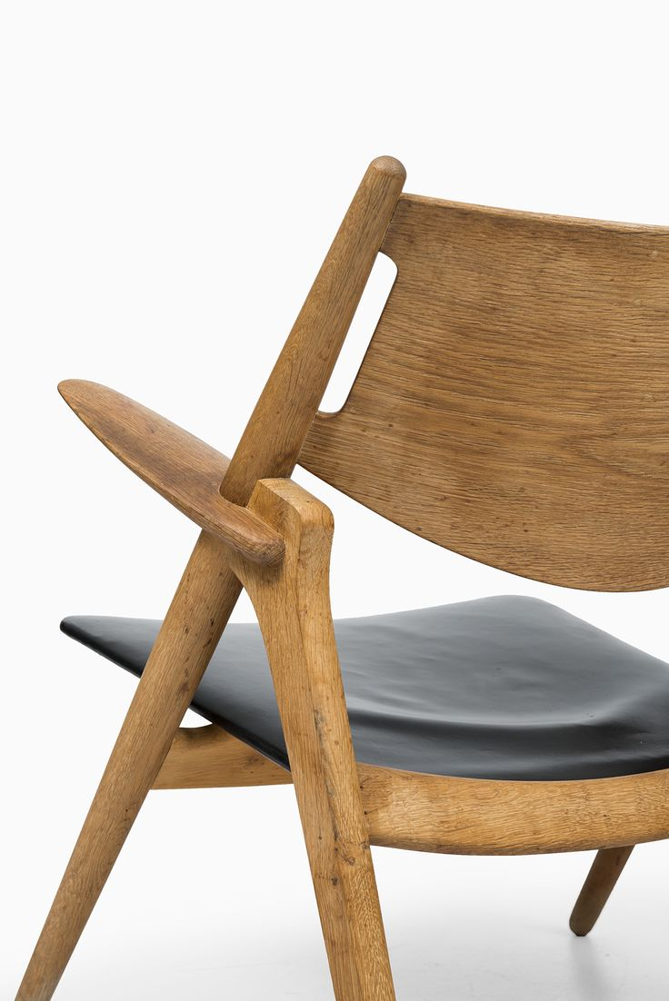 Wooden easy chair models - A Pair Of Easy Chairs Model In Oak And Black Leather Designed By Hans Wegner And Produced By Carl Hansen S N In Denmark