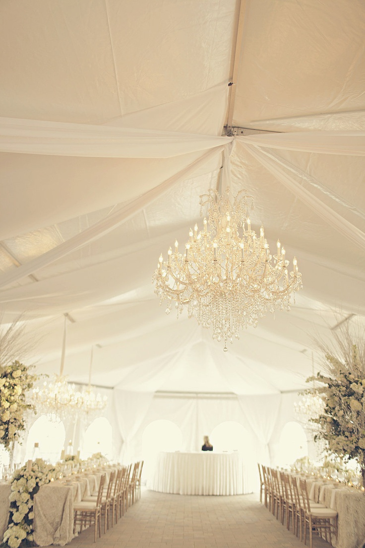 White wedding tent marquee with stunning crystal chandelier center stage