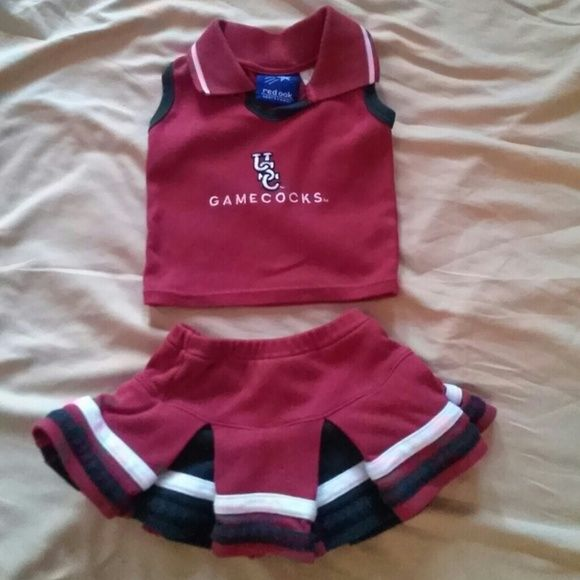 2 piece baby girl Gamecocks cheerleading outfit 2 piece cheerleading outfits Gamecock Burgundy, white and black.  Skirt has panties attached to it. Size 12 months worn but in good condition. My granddaughter of waters at 6 months through 9 months red oak sportswear Other