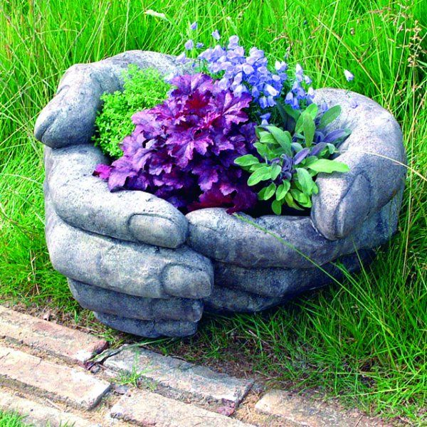 Cupped Hands garden sculpture. Make your own by filling a pair of gardening gloves with toufa and wrap them around an appropriate sized clay pot and allow to set. Cut and peel the gloves off