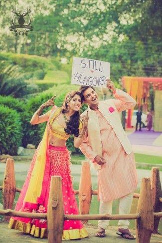 Indian wedding photography. Couple photo shoot ideas. Candid photography. Beautiful yellow and pink lehenga for mehendi #lehenga #mehendioutfit #wedmegood