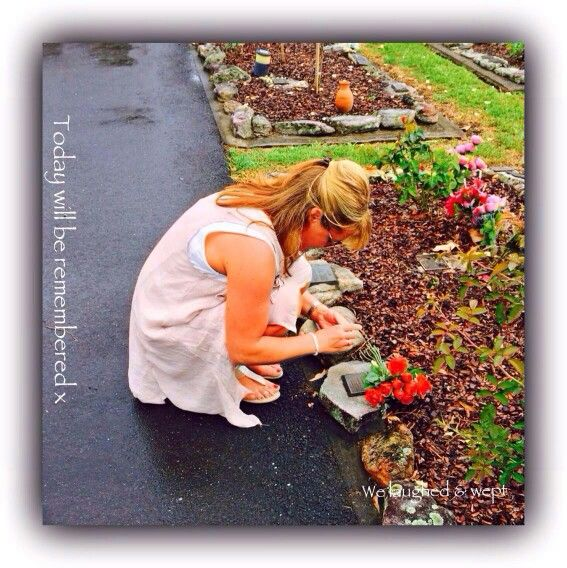 Charlotte laying roses @ Paul's resting place Feb 2014