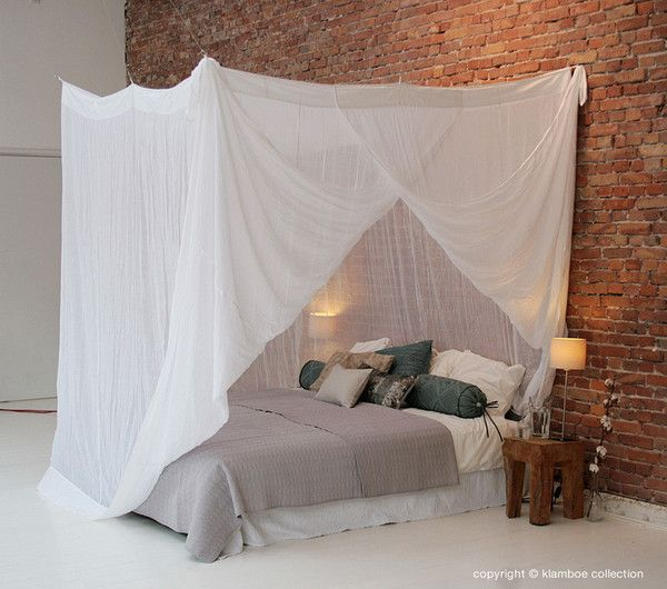 Rectangular COTTON Mosquito Net Rectangular cotton nets are available in four different widths in white or (very slightly) ecru. Just as with the rectangular polyester nets, metal rings are hung above the nets.  The rectangular cotton Mosquito Net can be attached to the ceiling and/or wall directly with strings. Another possibility is to install curtain rails along the bed and hang the net using the small rings located on top.