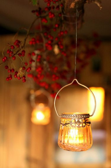 Hanging candle holders in the passageway will give a warm and quaint feel to your guests.