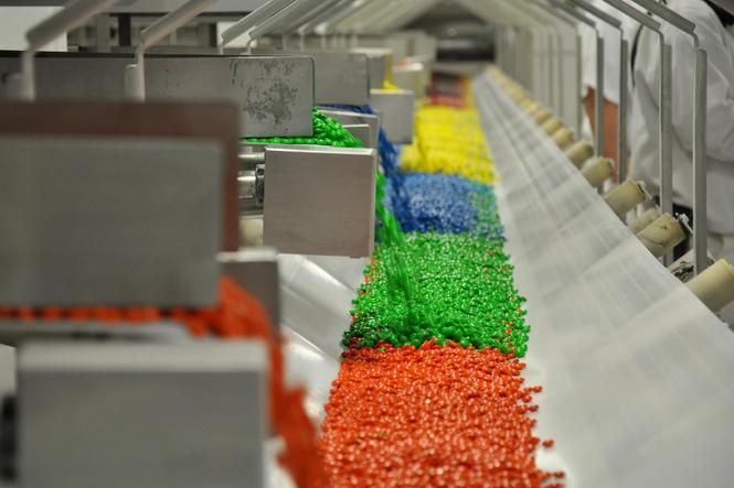 The doors to the secretive M&M's factory in Cleveland were opened for Gov. Bill Haslam Thursday, as he and local officials toured the Mars candy-making facility to mark the company's longstanding investment in Tennessee.