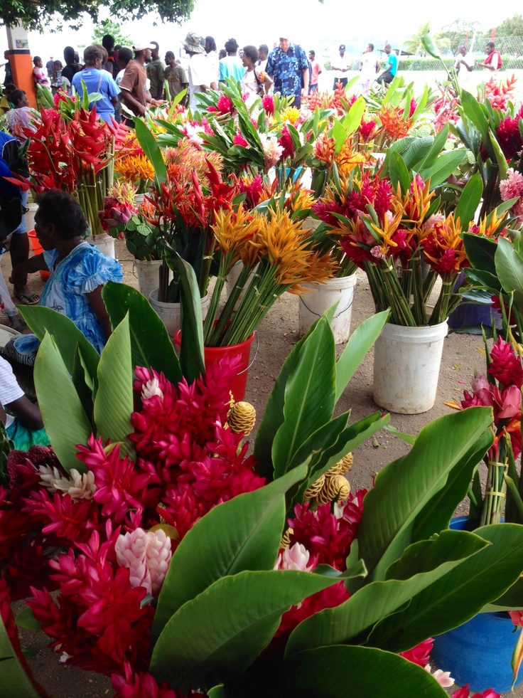"""Markets at Port Vila, Vanuatu. I love that every time we go """"home"""" my husband buys me a beautiful bunch if flowers from the markets. Even though we know we can't take them back to the country we live in."""