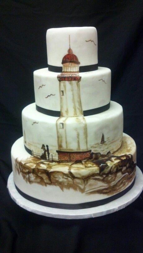 Hand painted lighthouse wedding cake