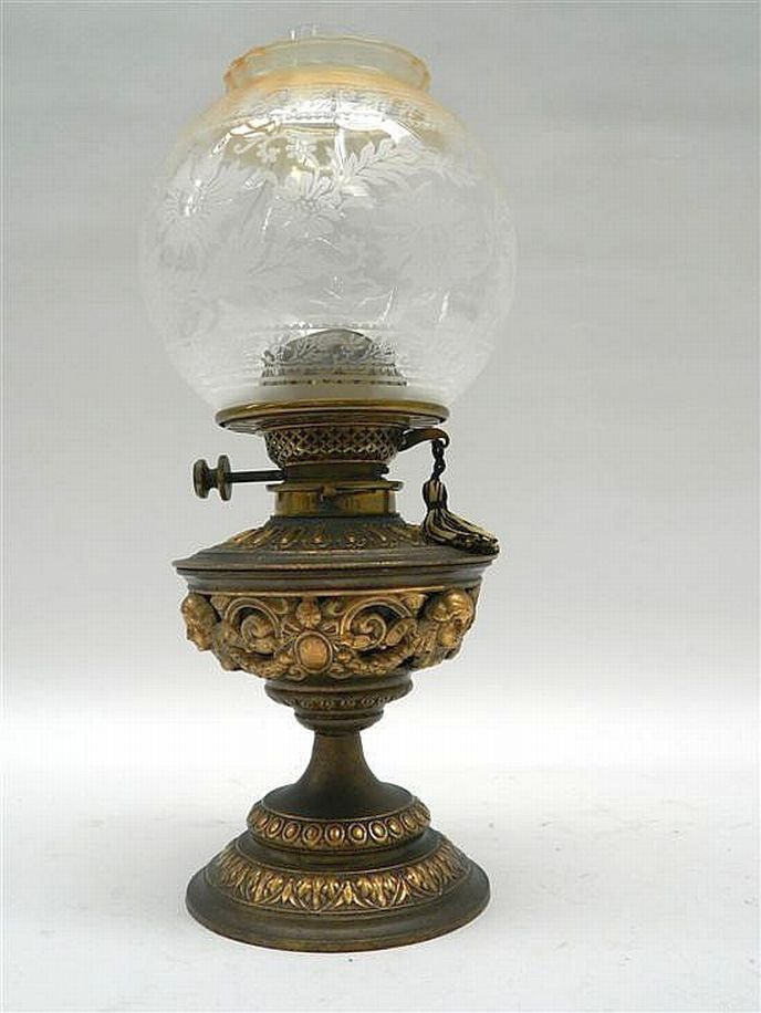 An English Edwardian table lamp by Hink's, with garland and… - Lamps - Kerosene - Lighting - Carter's Price Guide to Antiques and Collectables