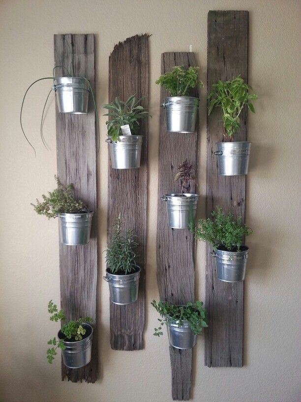 Creative Indoor Vertical Wall Gardens • Lots of Great Ideas and Tutorials! Including, this idea of small tin buckets attached to re-purposed wood. Love this look!