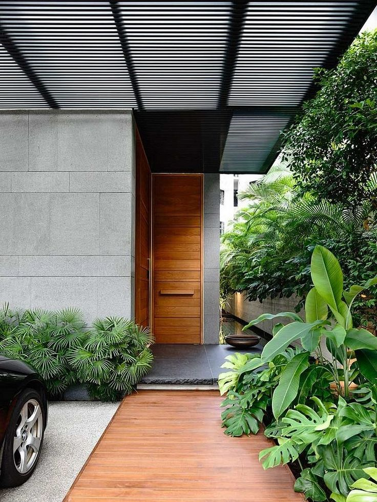 Minimalist House // Modern Wood Door / Walkway At The Entry Way / By ONGu0026ONG