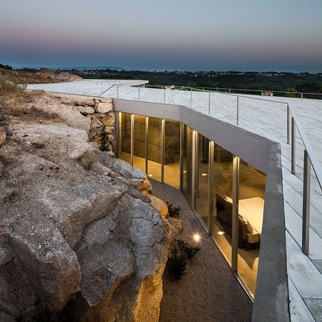 The sprawling topography of the Portuguese landscape provided the shape of this restaurant, guest house and wine showroom.