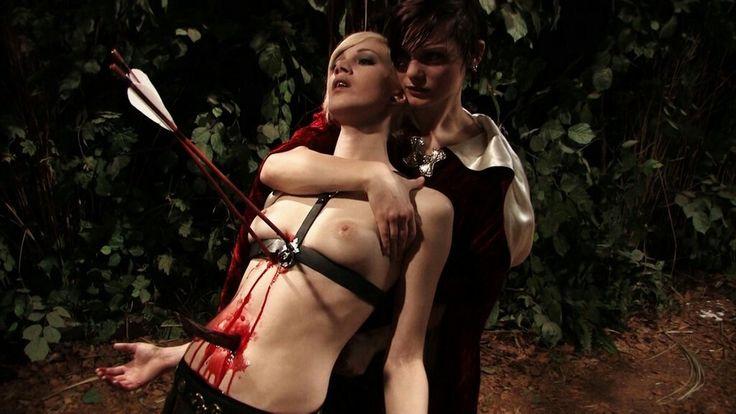 sexy woman shot by arrow