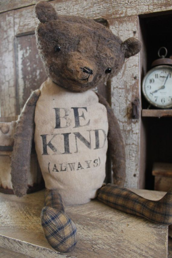 BE KIND (always) BEAR | Well, isn't he something ! A grungy bear with canvas body and homespun legs. A sweet message handstamped onto his body. He is 14'' tall sitting. As with all my bears, he is primitively made, but well made. It is not a jointed bear. All parts are hand sewn into place, although, it can be repositioned somewhat. A Cinnamon Creek tag will be attached. SOLD $80.00 1 of 2