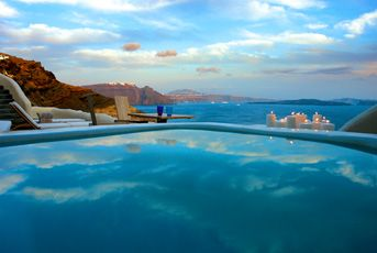 Mystique, Santorini.  Located on Oia's most famous cliffs with dazzling views of clear blue crystalline waters towards the volcano and the Aegean Caldera.