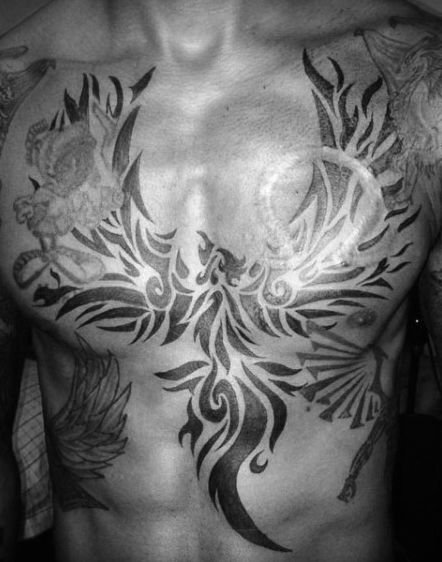 Awesome Guys Chest Tattoo Of Tribal Phoenix With Black Ink Design