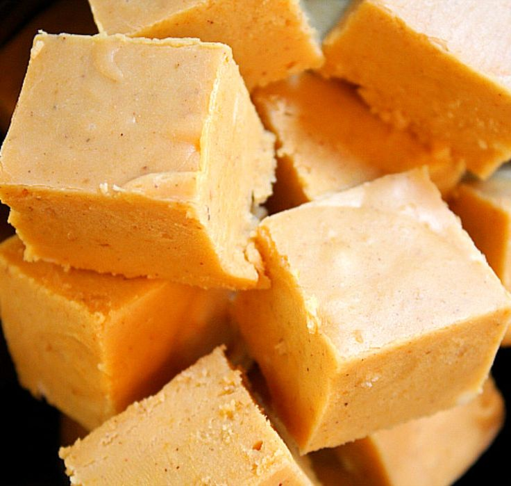Pumpkin Pie Fudge  2 c. sugar  1 c. brown sugar, packed  3/4 c. butter (no substitutions)  2/3 c. evaporated milk  1/2 c. pumpkin puree  1 1/2 tsp. Pumpkin Pie Spice  1 (12 oz.) pkg. white chocolate chips  1 (7 oz.) jar Marshmallow creme  1 c. chopped pecans or macadamia nuts (optional)  1 1/2 tsp. vanilla extract