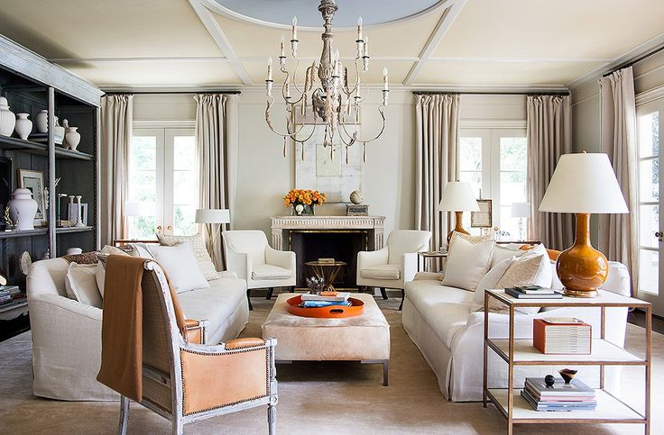 Suzanne added these geometric moldings to the family room ceiling, giving the space more of a presence. Painted ice blue, the center circle sets off the room's orange accents.