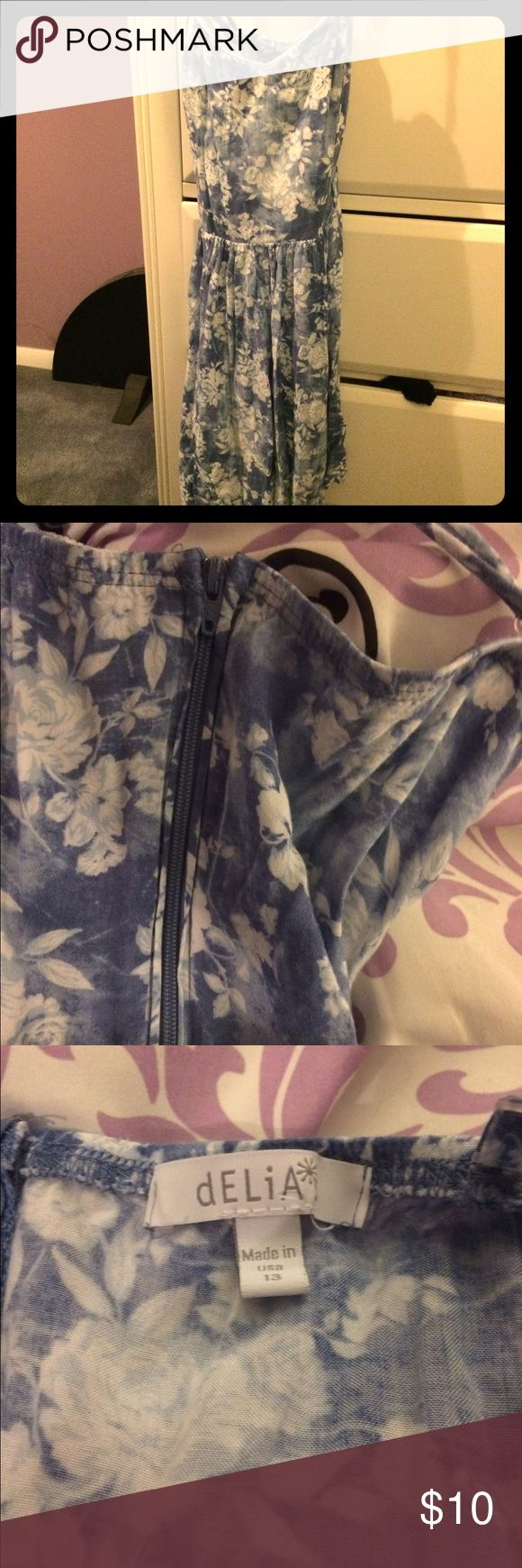 Blue & white floral dress Worn several times but in good condition. Side zipper. The straps are a bit funky, but ultimately they do a cross-cross thing in the back. Little lace decal along neckline. Delias Dresses Mini