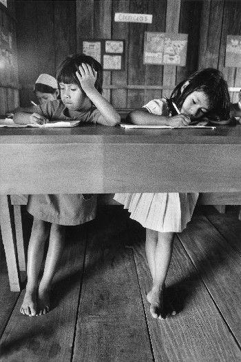 Sebastiao Salgado - important work for Humanity... school | desk | work | students | girls | bare feet | concentrating