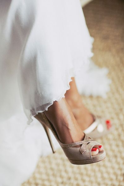 Gorgeous shoes and red nail polish, perfectly accentuating the beautiful white dress. . .  Absolute fav!