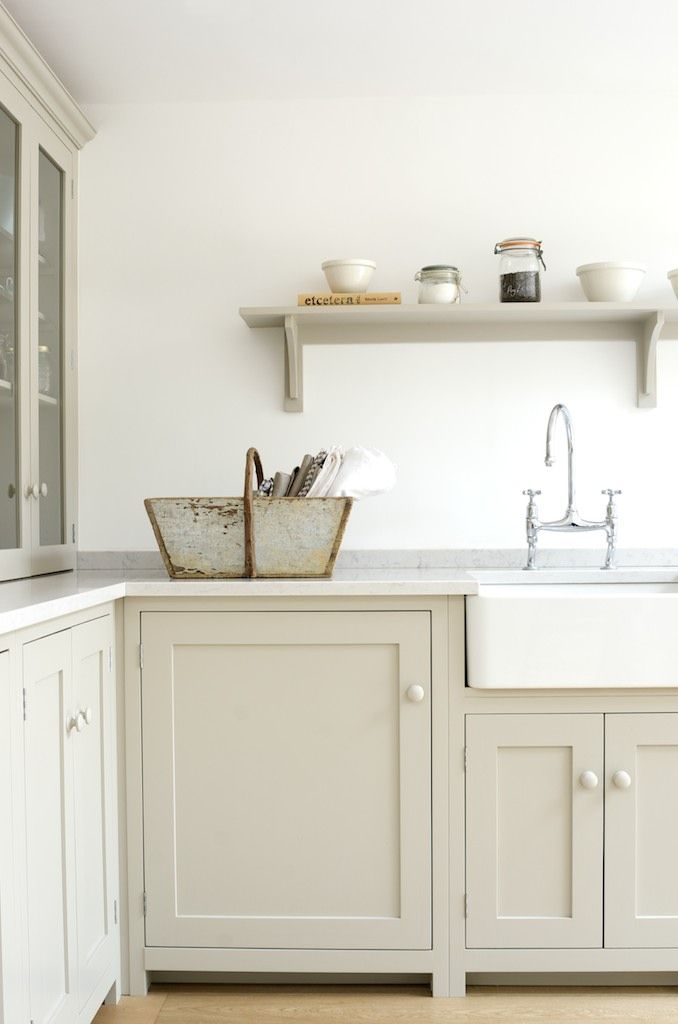 The Kew Shaker Kitchen by deVOL - An elegant townhouse in the delightful London suburb of Kew is the setting for this charming Shaker kitchen. The use of a simple shelf instead of wall cupboards gives an uncluttered feel, whilst 'Lagoon' Silestone worktops and 'Mushroom' paint add to the lightness of this kitchen.