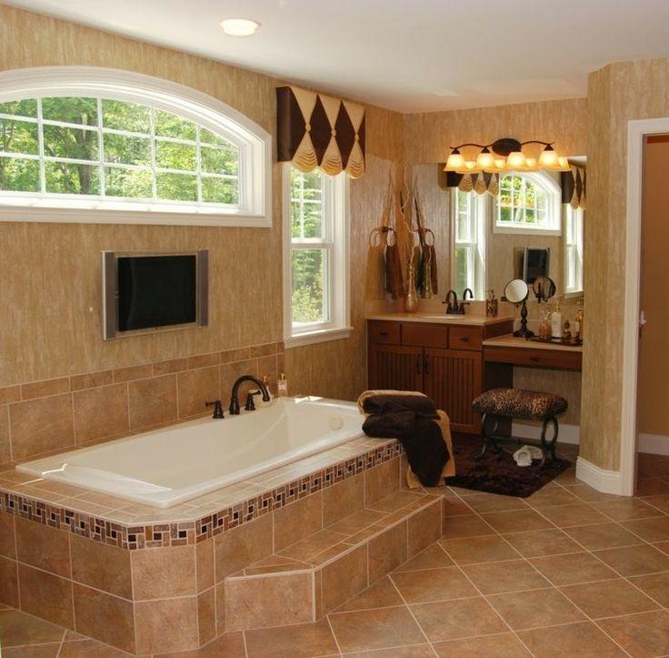 salle de bain de luxe de style colonial en couleurs terreuses