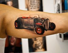 Old car tattoo on arm by Denis Sivak