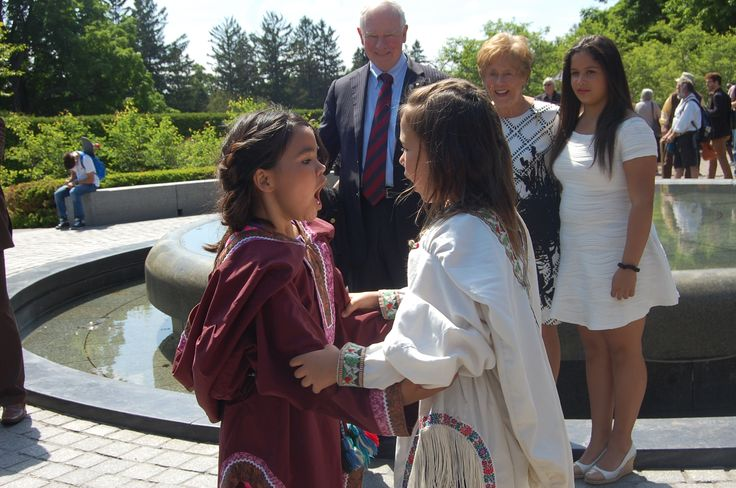 Governor General David Johnston and wife Sharon watch on as two young throat singers perform  at Rideau Hall in Ottawa on June 3, 2015..