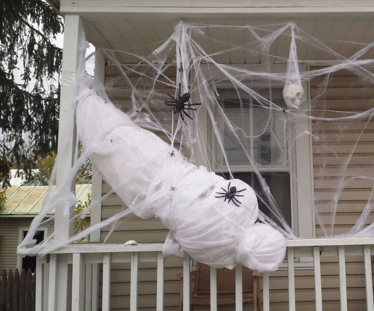 a life size spider victim - Halloween Ghost Decorations Outside