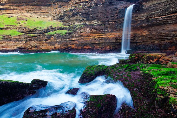 Waterfall Bluff. Wild Coast, South Africa. Water cascades over the lip of waterfall bluff for an 80m drop into the sea in the Pondoland area of South Africa's wild coast.