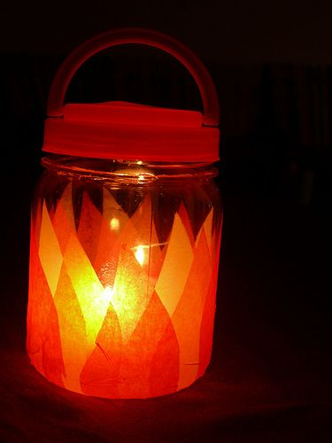 Kid's Camping Lantern, perfect for night hikes !  You will need:  A plastic jar with lid & handle   Tissue paper in orange,yellow and red  White glue  A battery operated tealight  *i want to tweak this and use can luminaries with the tea light!!