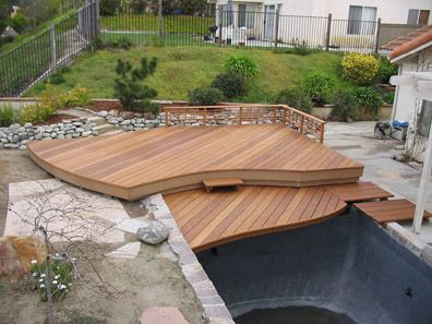 Koi pond deck water feature pinterest piscine for Koi pond deck