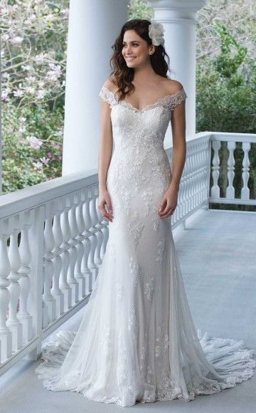 Sincerity Bridal 3938 Beautiful lightweight lace Wedding Dress with off the shoulder neckline and low Illusion back at Blessings Wedding Dress Boutique, Brighton, East Sussex. BN1 5GG. Telephone: 01273 505766