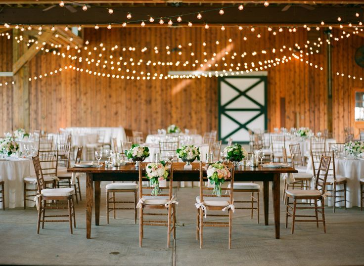 Hanging Lights For Wedding: Lots of festoon lights, hung in a low flat canopy.,Lighting