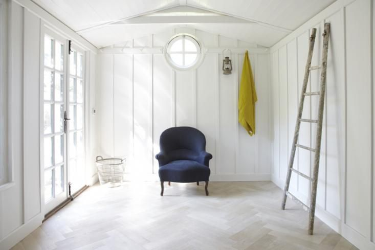 Twig Hutchinson, Lorn Road Summerhouse, blue chair with yellow cloth, Remodelista
