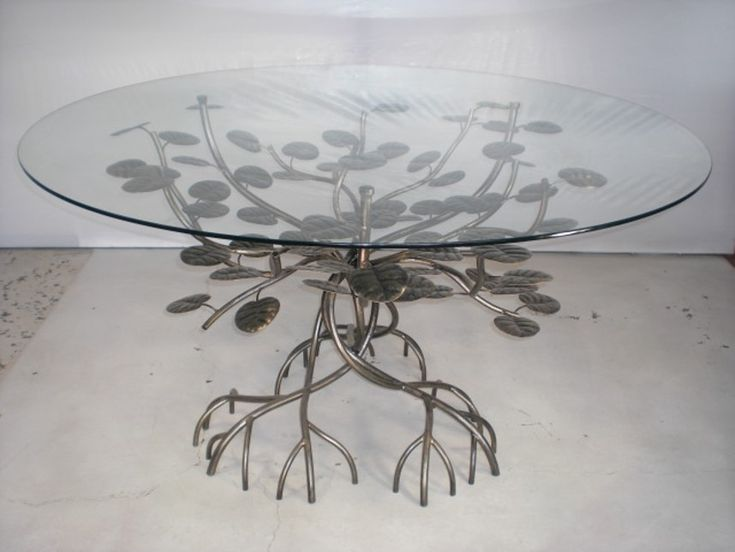 Mangrove Table Of the multiple sources of inspiration in the tropics, this steel mangrove occasional table is a departure from the everyday, to justify its natural sheen, a hand finished three tone wash technique is applied that is so representative of the actual shrub. The glass is sustained on the occasional branch making the mechanism almost invisible. For more information visit us at 205 San Francisco st. old San Juan Puerto Rico or call us at (787) 403-0095 / (787) 932-0086