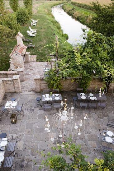 Outdoor living al fresco /\ /\ . Medieval mill in Treviso, Italy
