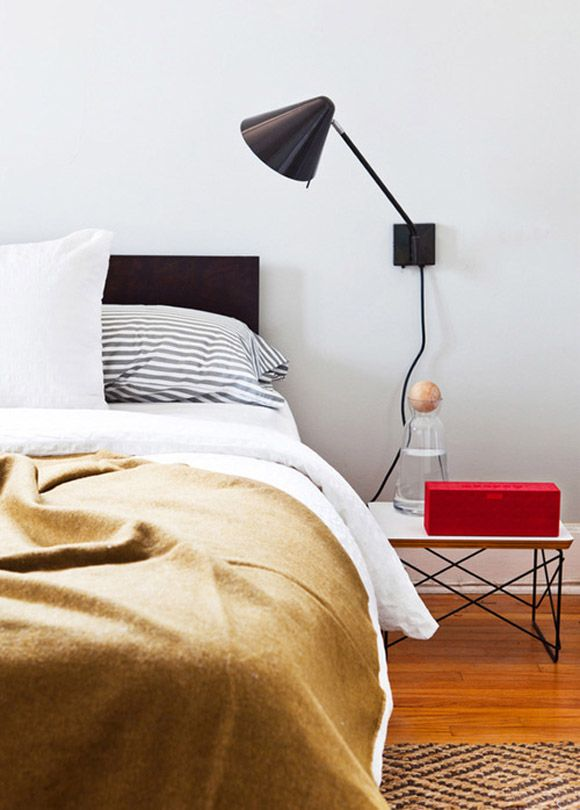 Some of my favorite masculine bedroom colors combined here, for sure. The camel blanket and Jawbone BIG JAMBOX in red make this great.