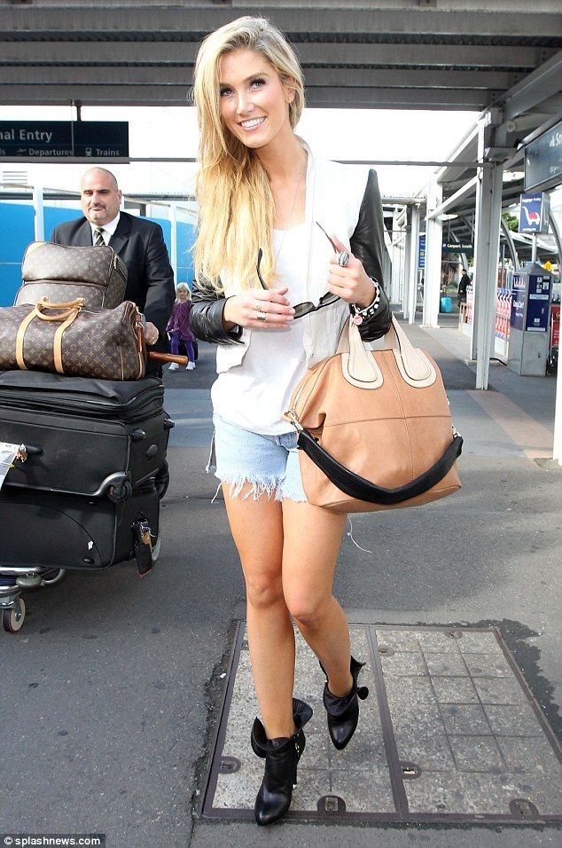 Delta Goodrem uses Tumi (and LV) Luggage