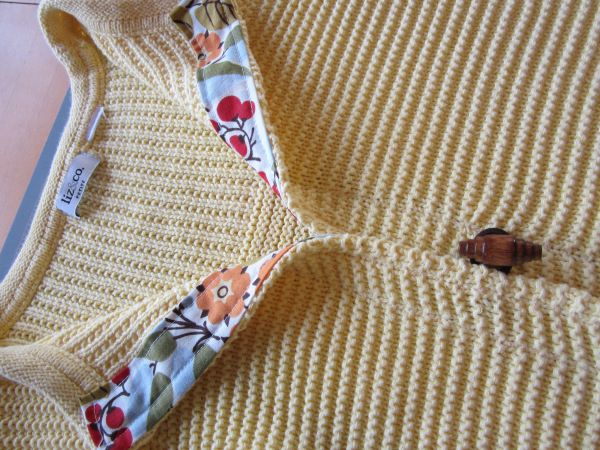I refashioned this sweater for my sister's Christmas gift. In addition to the sweater this was all I needed. A button, a hairband and a strip of fabric. First I cut the sweater up the middle.…