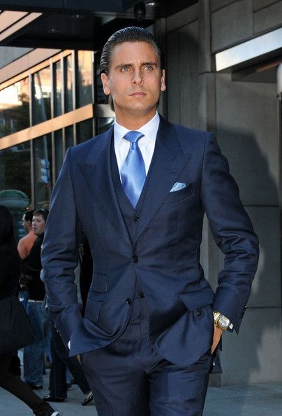 Scott Disick in a sheen 3 piece navy suit. He pulls off the ticket pocket