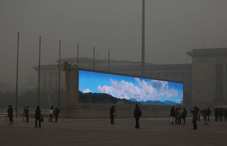 A bright video screen shows images of blue sky on Tiananmen Square during a time of dangerous levels of air pollution, on January 23, 2013 in Beijing. That's some dystopian shit right there! (You know, you could argue that if people from the past saw our society today, they would see it as a dystopia.)