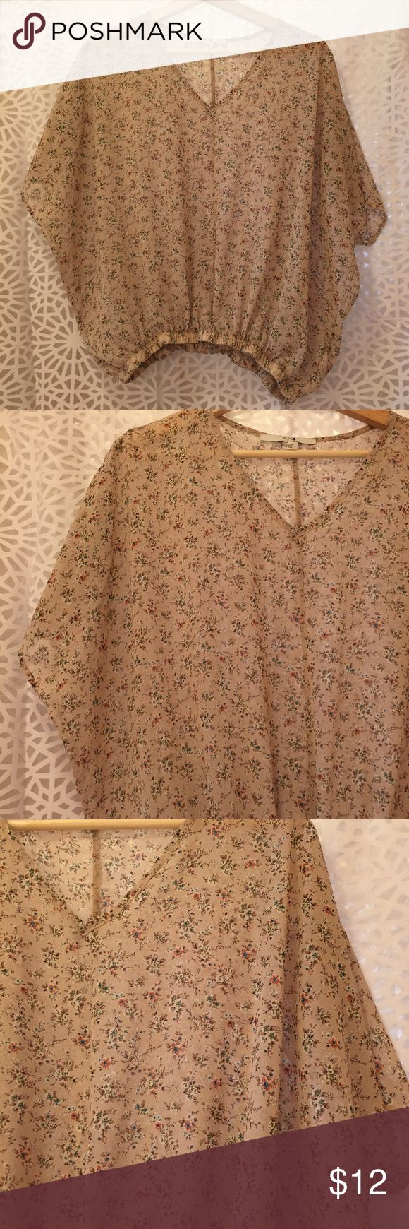 XXI Floral Top XXI Floral Batwing Top. Very Breezy & Pretty Sheer Layering Piece. Loose, Blousy Fit. Delicate Floral Pattern on a Creamy Light Tan Background. (Last Photo Shows the Best Indication of the True Color) Elastic Waist. Very Pretty & Clean Condition. XXI Tops