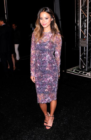 Actress Jamie Chung poses backstage at the Monique Lhuillier fashion show during Mercedes-Benz Fashion Week Spring 2015 at The Theatre at Lincoln Center on September 5, 2014 in New York City.  (Photo by Stephen Lovekin/Getty Images for Mercedes-Benz Fashion Week)