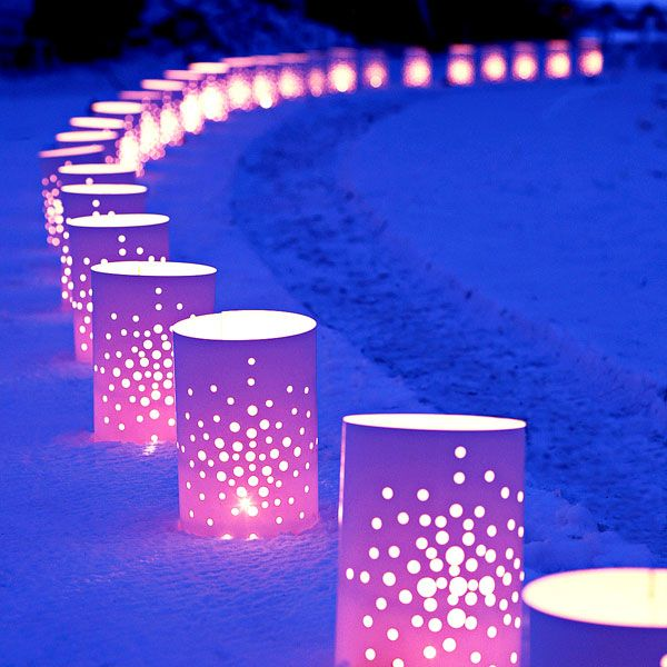 Christmas Luminaries - Lowe's Creative Ideas. 10-inch-tall cylinders are made of white plastic flashing. Drill holes in the plastic to create your own design -- stack pieces to drill multiples quickly. Tuck the cylinders into the snow or grass on either side of the path and then add candles.