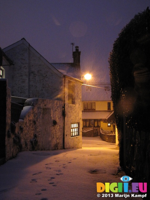 Snow falling outside house with lights on, Llantwit Major