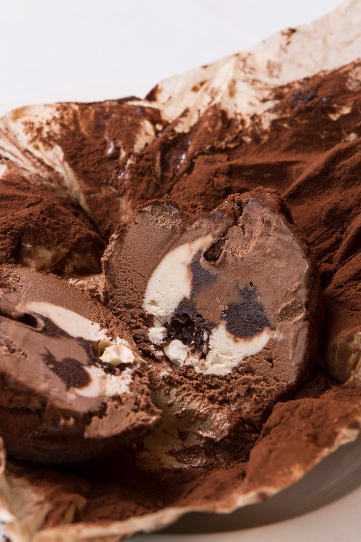 This tartufo di Pizzo recipe is one of Francesco Mazzei's favourite dishes from Calabria in Italy. Unwrapping the paper exterior reveals a chocolate ice cream bombe with a hidden centre of hazelnut ice cream, sugared hazelnuts and thick chocolate sauce.