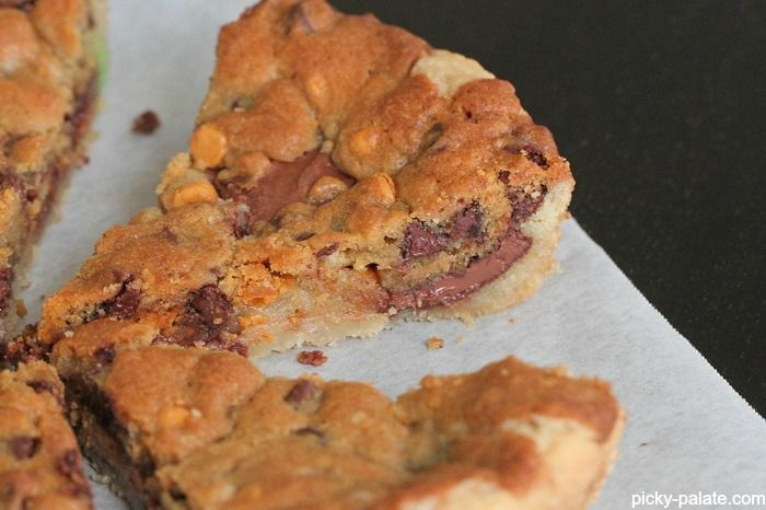 Skillet Baked Candy Bar Stuffed Double Cookie - Picky Palate